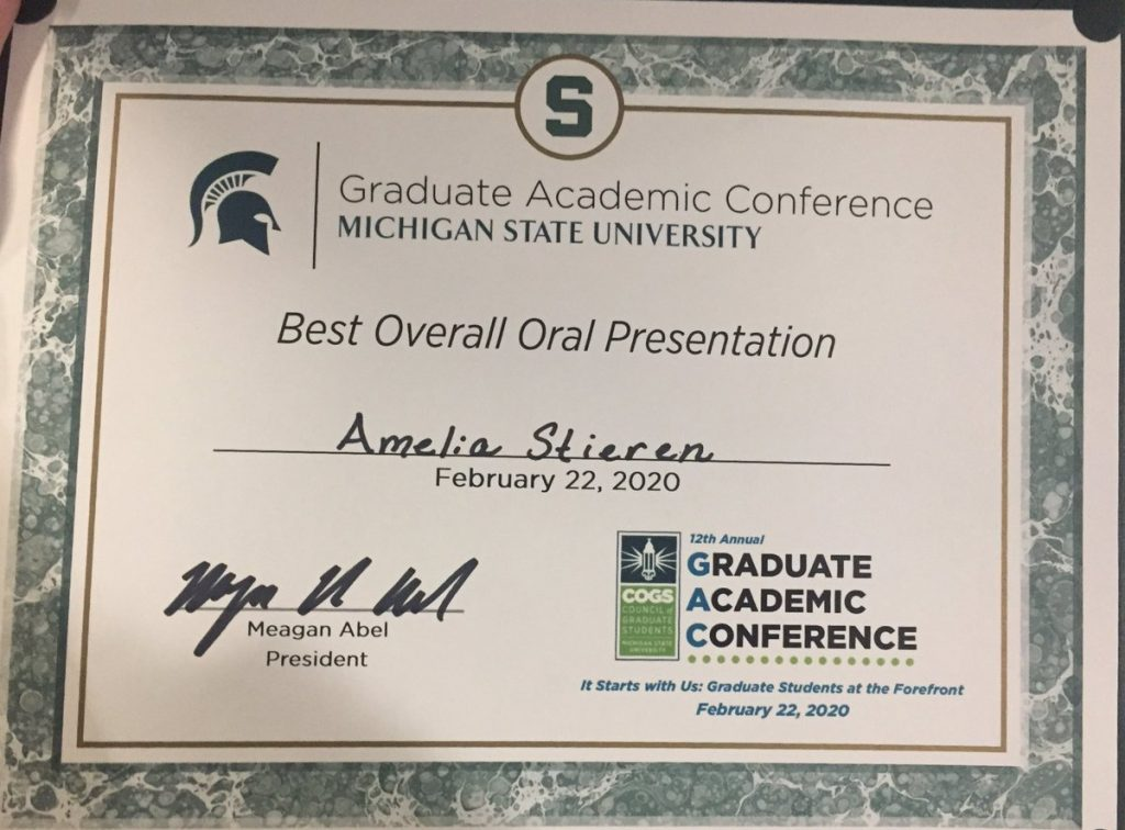 green and white paper certificate for Best Overall Oral Presentation